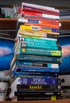 The stack of books generated during my MSIT program at Marlboro College Graduate School